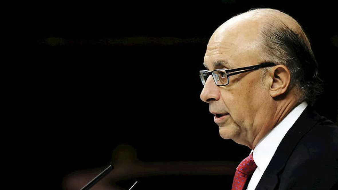 Boletines RNE - Los funcionarios cobrarán en enero una cuarta parte de la paga extra de 2012 - 12/11/14 - Escuchar ahora