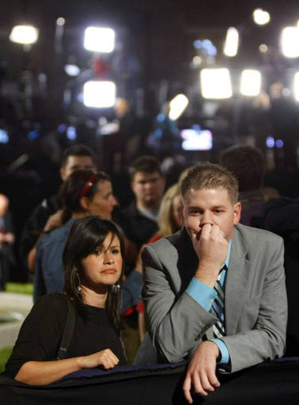 Guests react after U.S Republican presidential nominee Senator John McCain's concession speech in Phoenix