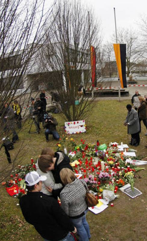 Students mourn at the Albertville-Realschule school where a shooting incident took place in Winnenden