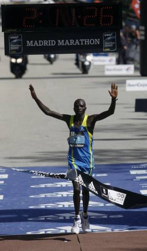 Cherogony of Kenya celebrates as he crosses the finish line of the XXXIII Madrid marathon
