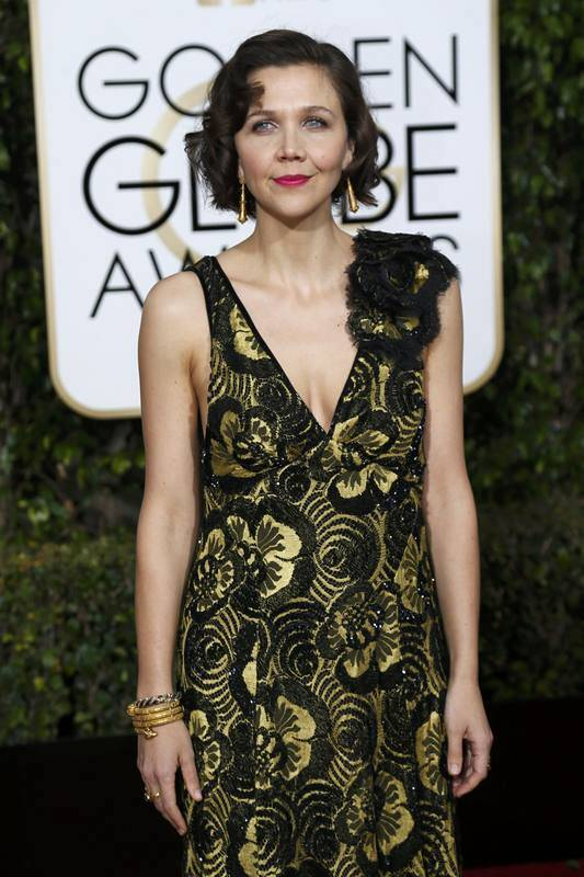 Actress Maggie Gyllenhaal arrives at the 73rd Golden Globe Awards in Beverly Hills