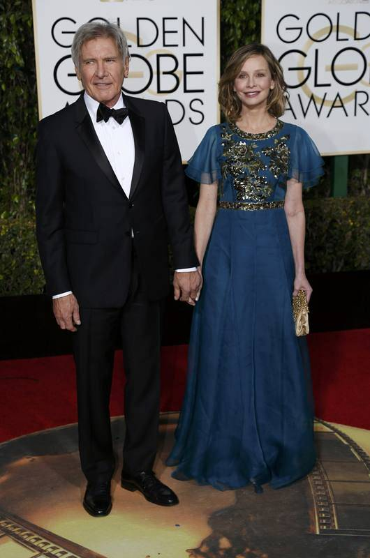 Actors Harrison Ford and Calista Flockhart arrive at the 73rd Golden Globe Awards in Beverly Hills