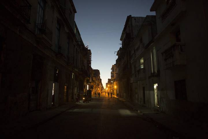 People walk on the street in downtown Havana