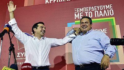 El líder de Syriza, Alexis Tsipras (izda.), y el de Griegos Independientes, Panos Kamenos, tras la victoria en las elecciones generales griegas