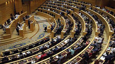 Un momento del pleno del Senado que debate y vota el proyecto de ley orgánica que regula la abdicación del Rey Juan Carlos.