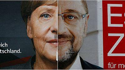 Fotomontaje con los carteles electorales de Merkel y Schulz