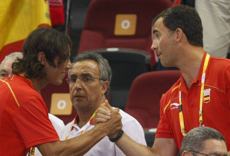 Spanish tennis player Rafael Nadal greets Spain's Prince Felipe during the men's Group B basketball game between Spain and Greece at the Beijing 2008 Olympic Games