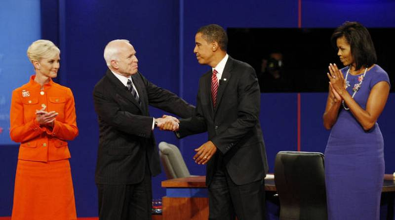 Obama and McCain stand with their wives as they conclude their presidential debate at Hofstra University in Hempstead, New York