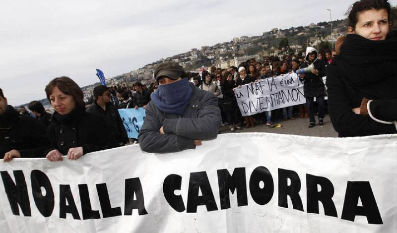 "Demonstrators hold a banner reading ""No to the Camorra"" as they march in the southern city of Naples"