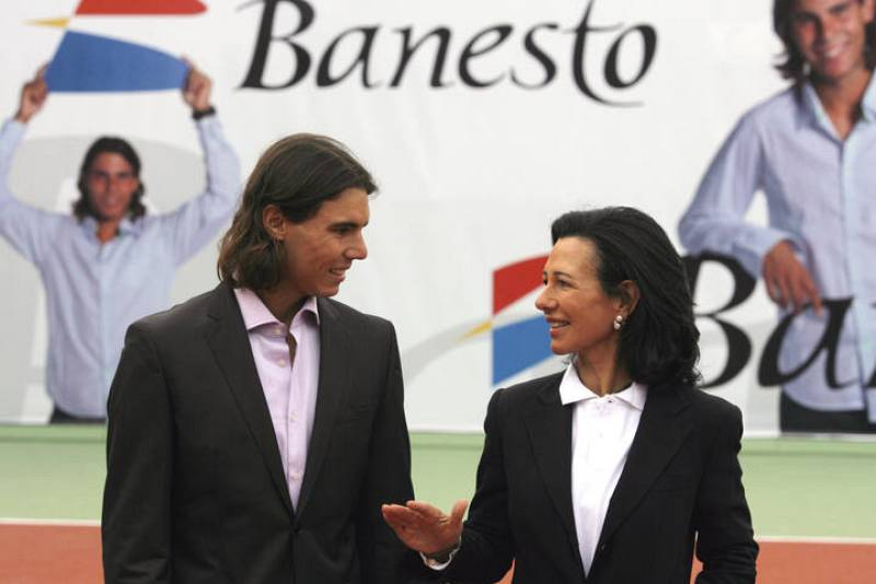Spain's Nadal listens to Banesto chairwoman Botin during an event in Madrid