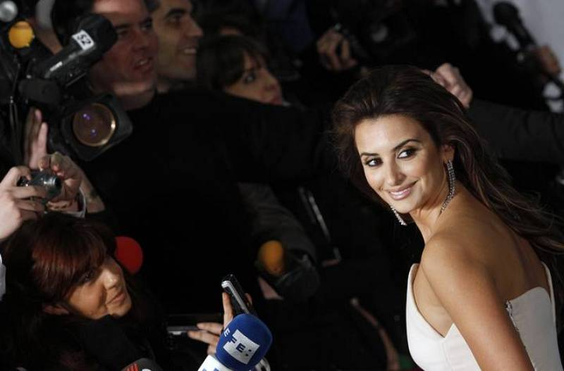 Spanish actress Cruz poses for photographers after her arrival for the Spanish Film Academy's Goya awards ceremony in Madrid