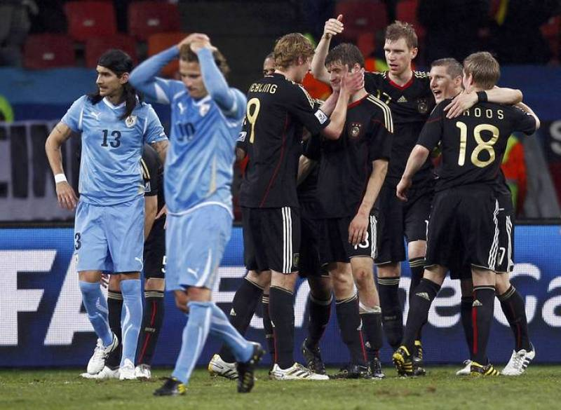 Uruguay's Diego Forlan and teammate Sebastian Abreu react after the final whistle in Port Elizabeth
