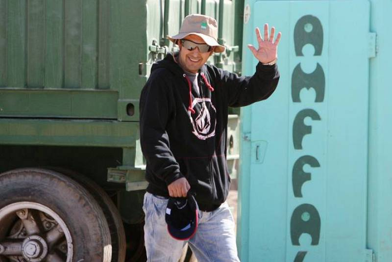 Rescued Chilean miner Daniel Herrera waves as he arrives at the San Jose mine