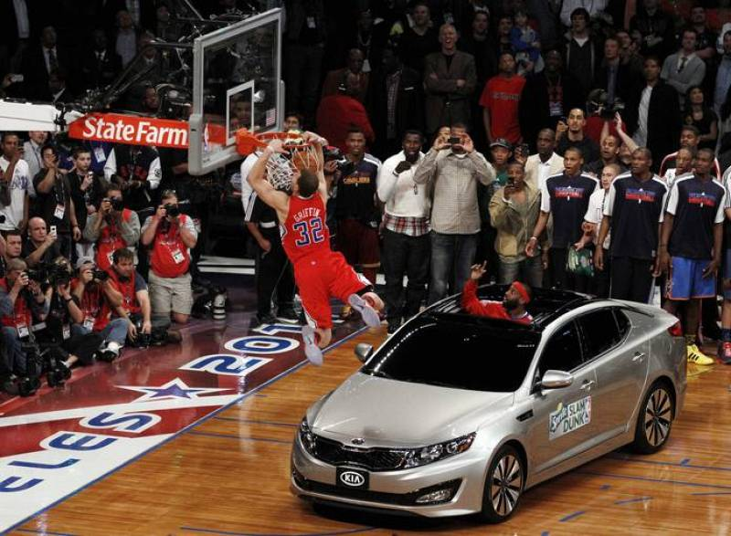 Clippers' Blake Griffin jumps over a car while competing in the slam dunk contest during the NBA All-Star weekend in Los Angeles