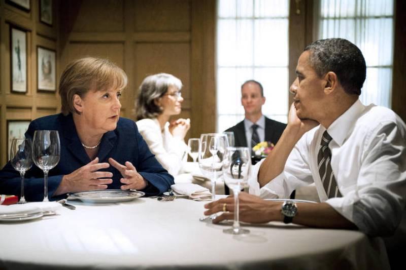 El presidente de EE.UU., Barack Obama, y la canciller alemana, Angela Merkel, en una cena privada en el restaurante 1789 en Washington.