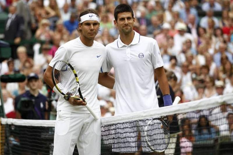 Rafael Nadal y Novak Djokovic, en el tradicional posado previo al inicio del partido