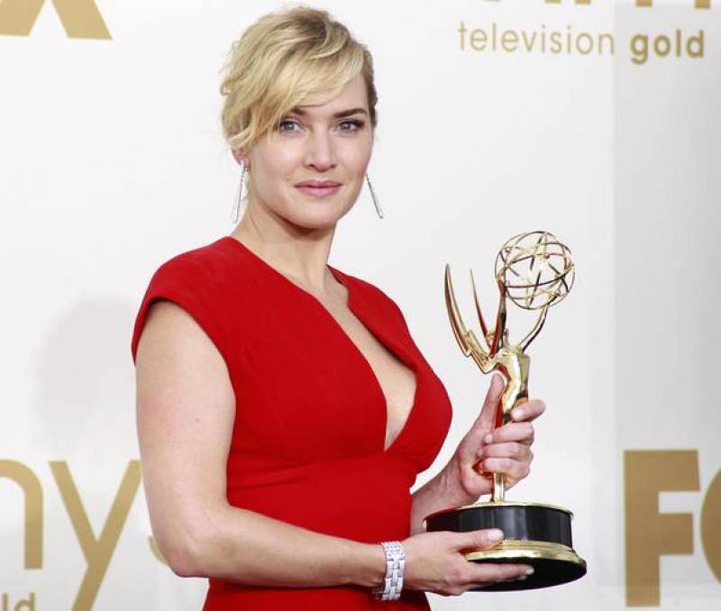 "Actress Winslet holds her Emmy award for outstanding lead actress in a miniseries or a movie ""Mildred Pierce"" at 63rd Primetime Emmy Awards in Los Angeles"