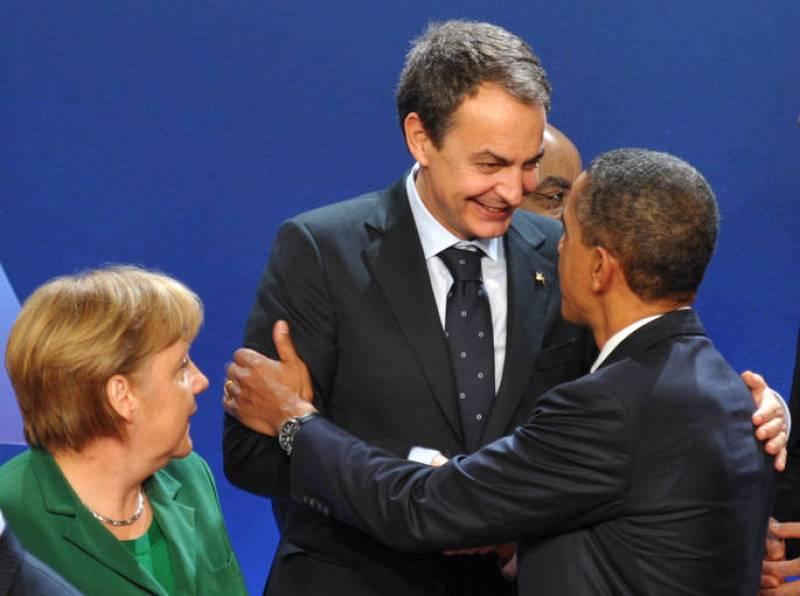Barack Obama y El presidente José Luis Rodríguez Zapatero se saludan en la cumbre del G-20 en Francia