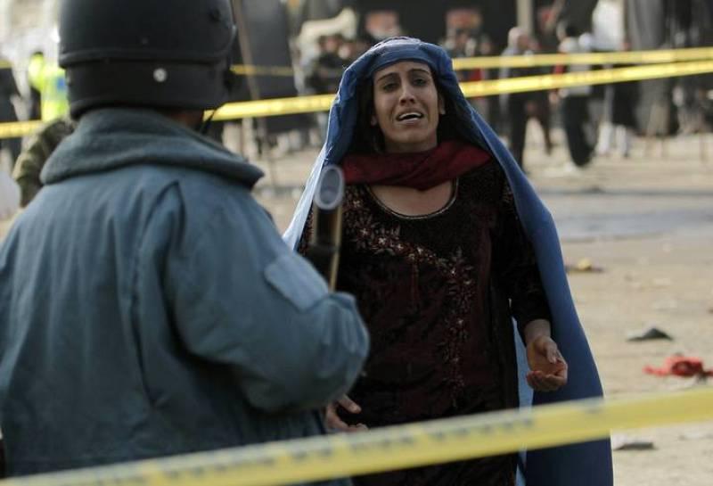 Una mujer afgana, imagen del sufrimiento tras la masacre