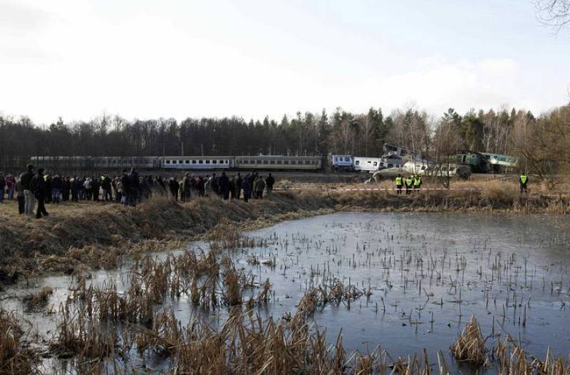 Onlookers gather at the site of a train crash near the town of Szczekociny