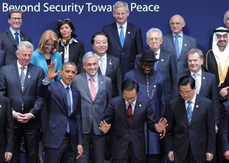 Foto de familia de los líderes que han asistido a la II Cumbre de Seguridad Nuclear, celebrada en Corea del Sur