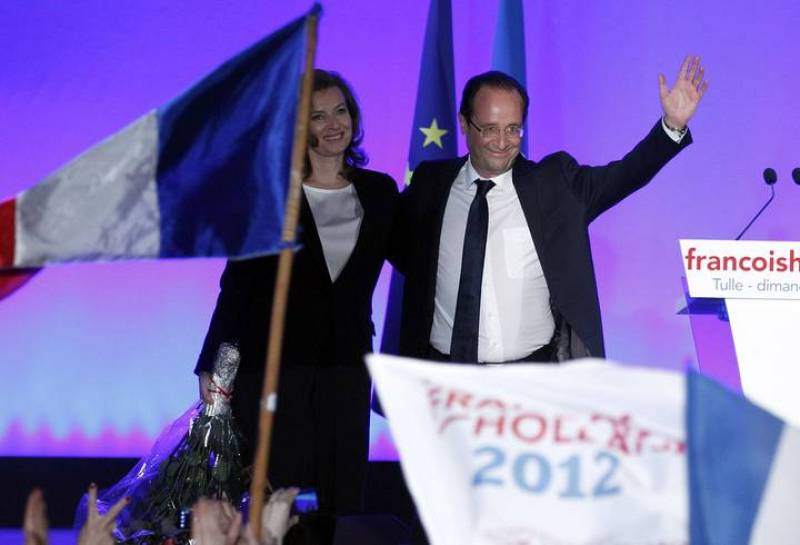 Francois Hollande, Socialist party presidential candidate, celebrates with his companion Valerie Trierweiler after results in the second round vote of the 2012 French presidential elections in Tulle