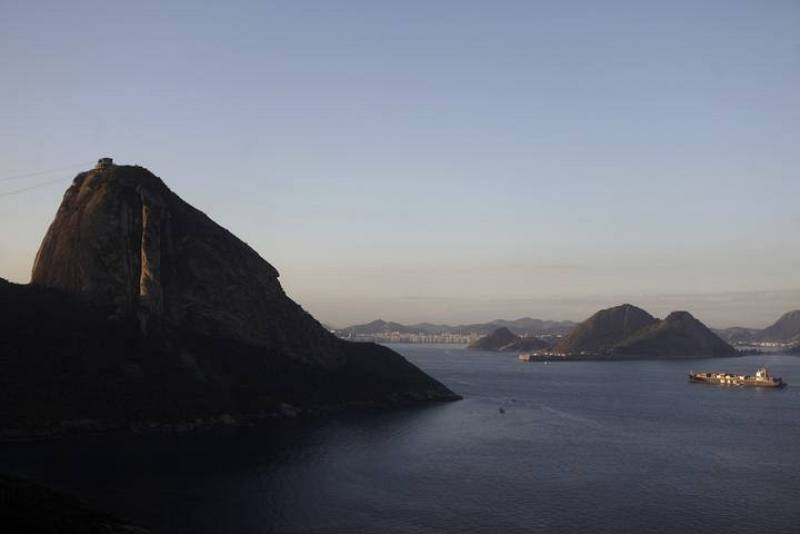 A ship navigates Guanabara Bay next to the famous Sugar Loaf mountain in Rio de Janeiro