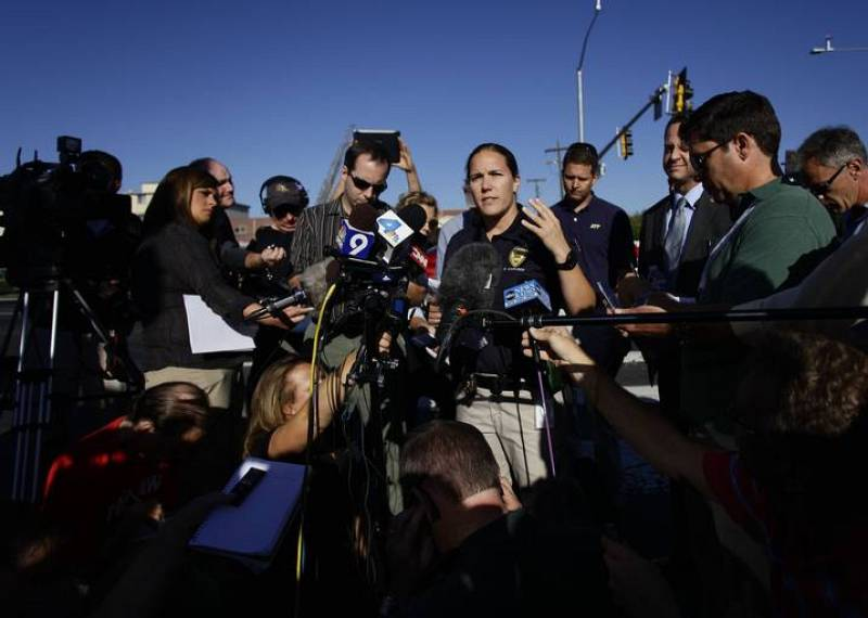Aurora police spokeswoman Carlson briefs reporters during a news conference near the apartment complex where suspect Holmes lived in Aurora