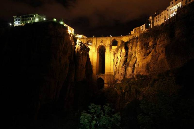 "The ""Puente Nuevo"" (New Bridge) is seen illuminated by artistic lights after Earth Hour in Ronda, near Malaga, southern Spain"