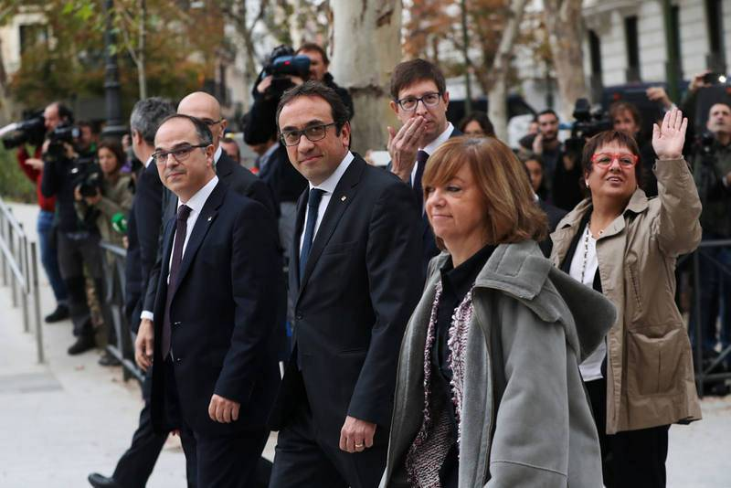 Dismissed Catalan cabinet members arrive to Spain's High Court after being summoned to testify on charges of rebellion, sedition and misuse of public funds in Madrid