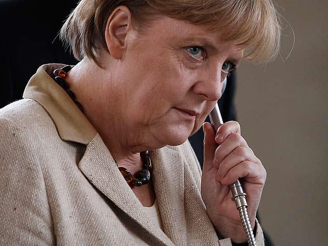 """Sarkozy y Merkel apoyan el futuro de Grecia en el euro por su """"determinación"""" en las reformas"""
