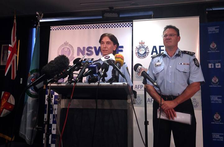 Australian Federal Police Deputy Commissioner Michael Phelan listens as New South Wales Deputy Police Commissioner Catherine Burn speaks during a media conference in Sydney