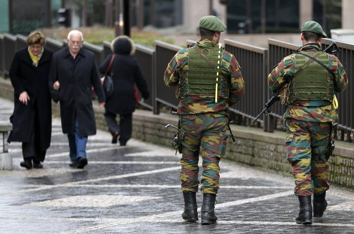 Belgian soldiers patrol outside the European Council building in Brussels