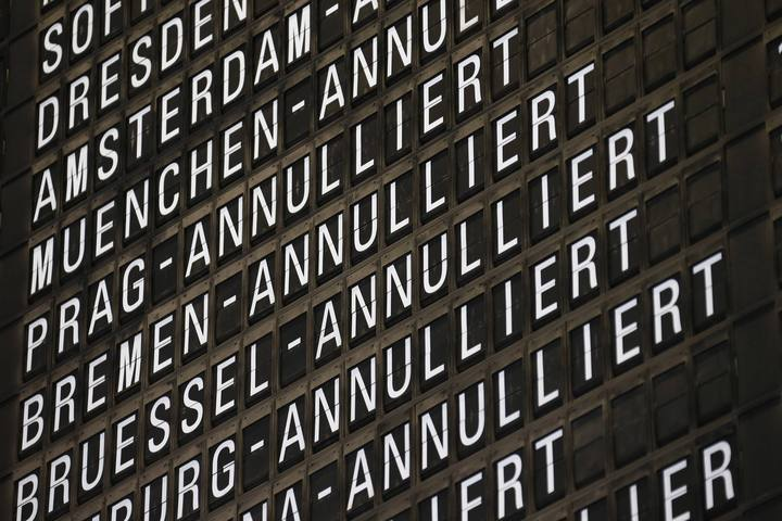Cancelled flights of German airline Lufthansa are displayed on a flight schedule board during a strike at the Frankfurt airport, in Frankfurt