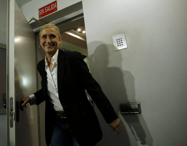 Cifuentes, Madrid's regional candidate of ruling People's Party (PP), smiles as she enters at press room inside PP headquarters after the regional and municipal elections in Madrid