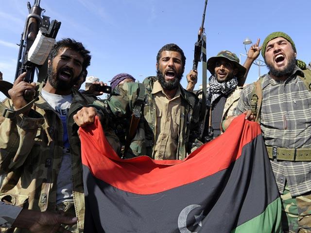 El Consejo Nacional de Transición comunica la muerte de Gadafi tras la caída de Sirte