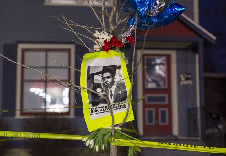 File photo of a makeshift memorial paying tribute to a 19-year-old black man killed by police in Madison