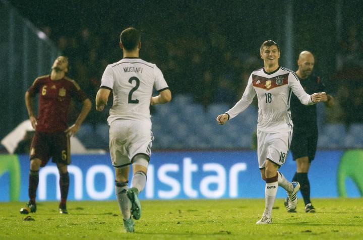 Germany's Kroos celebrates his goal against Spain with his teammate Mustafi during international friendly soccer match at Balaidos stadium in Vigo