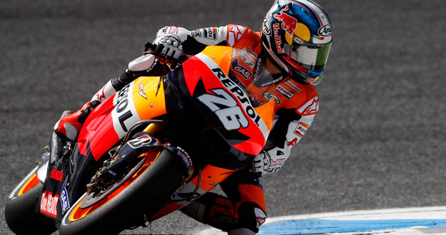 Honda MotoGP rider Pedrosa takes a curve during the first free practice session at the Portuguese Grand Prix in Estoril