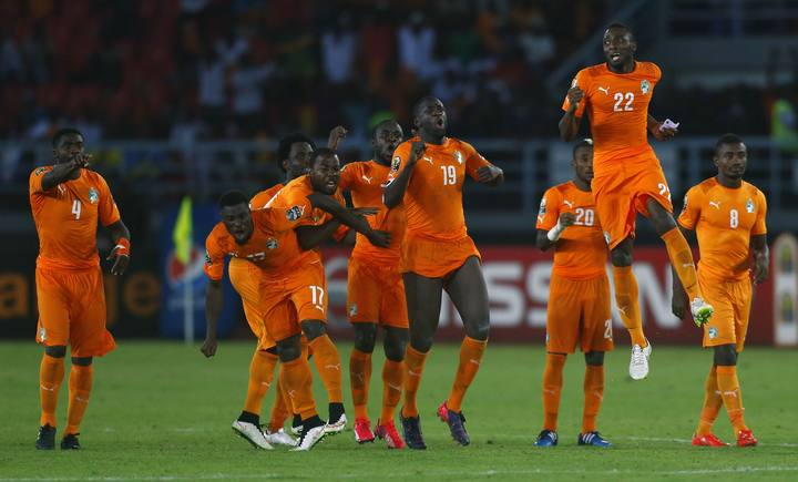 Ivory Coast's players celebrate winning the African Nations Cup final soccer match against Ghana in Bata