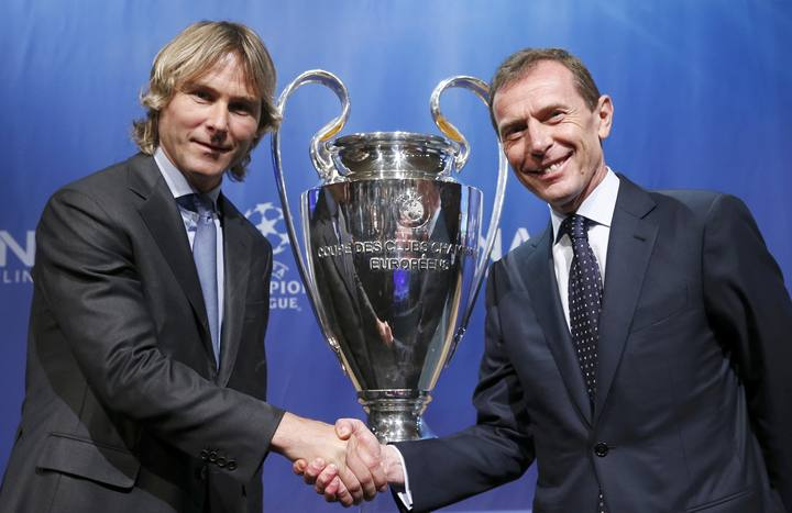 Juventus? ambassador Nedved shakes hand with Real Madrid's ambassador Butragueno after the draw for the Champions League semi-finals matches at the UEFA in Nyon