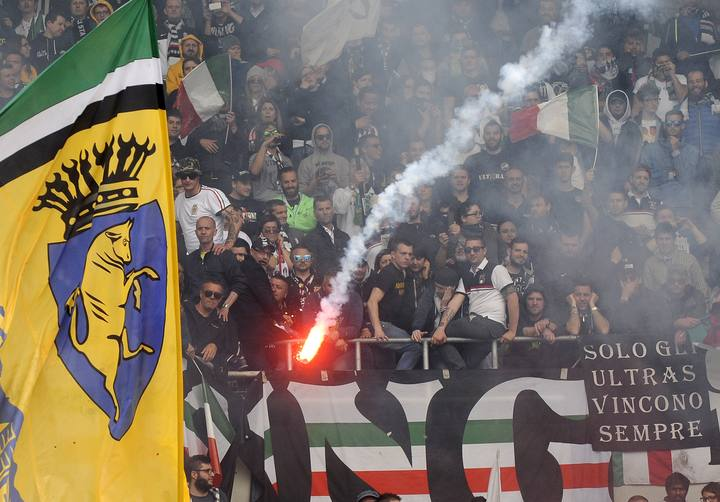 Juventus' supporters look on as a flare is thrown during their Italian Serie A soccer match against Torino in Turin
