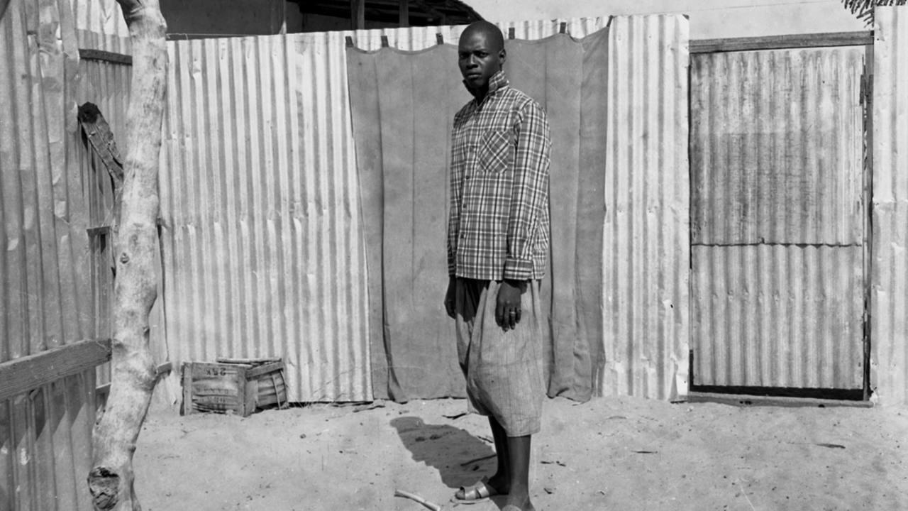 'Man Standing in a Courtyard' (1959-68).Oumar Ka.