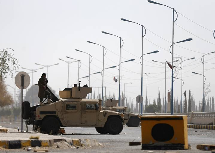 A member of the presidential guards stands on an armoured personnel carrier blocking a road leading to the presidential palace in Sanaa