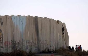 Informe semanal - Palestinos, prisioneros del muro