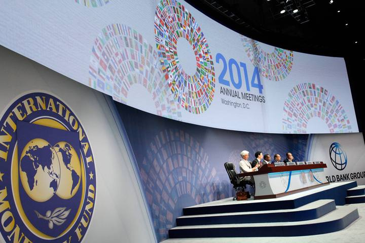 Participants sit at the head table at the plenary session at the IMF-World Bank annual meetings in Washington