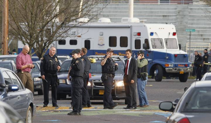 Police investigate outside the Rosemary Anderson High School in Portland, Oregon
