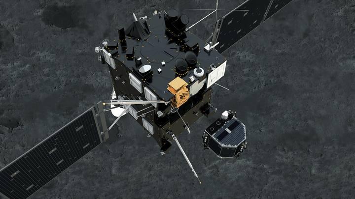 En primer plano la sonda Rosetta en el momento de separarse de Philae.