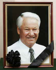 A picture of former Russian president Boris Yeltsin is seen with a black ribbon at the Russian embassy in Warsaw