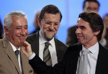 Spain's PM Mariano Rajoy, former PM Jose Maria Aznar and Andalusian People's Party (Partido Popular) President Javier Arenas smile during the national congress in Seville